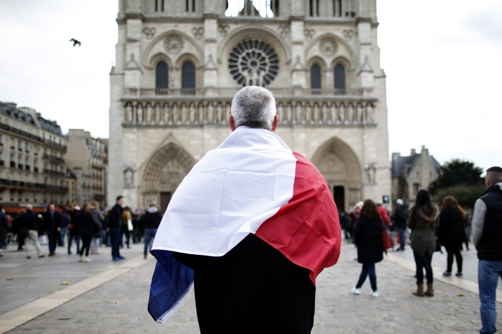 french-tourist-holding-France-flag